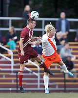 Boston College defender Nick Corliss (5) and Syracuse University forward Emil Ekblom (14) battle for head ball. Boston College (maroon) defeated Syracuse University (white/orange), 3-2, at Newton Campus Field, on October 8, 2013.