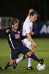 13 November 2009: Virginia's Ari Dimas (19) and Wake Forest's Corben Bone (right). The University of Virginia Cavaliers defeated the Wake Forest University Demon Deacons 4-3 on penalty kicks after the game ended in a 0-0 tie after overtime at WakeMed Stadium in Cary, North Carolina in an Atlantic Coast Conference Men's Soccer Tournament Semifinal game.