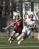 Boston College defender Kara O'Connell (10) brings the ball forward as Harvard University defender/midfielder Lauren Tomkinson (3) pressures.