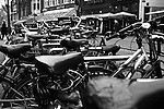 A row of bicycles crowds a sidewalk in  Amsterdam, Netherlands. Feb. 28, 2009.