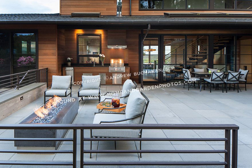 Patio area with outdoor dining table and firepit with comfortable seating.