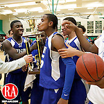 Waterbury, CT- 02, March 2011-030211CM19 Crosby senior, Kadeem Graham kisses the trophy as teammate Todd Smith celebrates, after defeating Holy Cross 77-61 at Wilby High School in Waterbury Wednesday night. Crosby won it's 8th straight NVL basketball championship.  Christopher Massa Republican-American