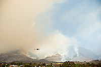 Santa Barbara, California: Smoke from Jeusuita fire fills sky with helicopter in foreground. May 8, 2009