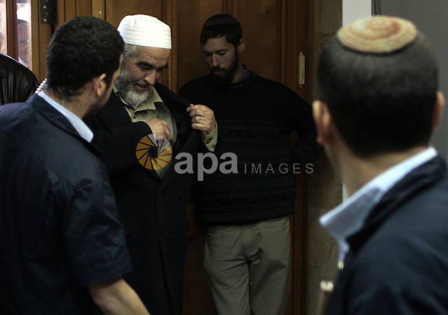 Head of the Islamic northern Movement of Israel, Sheikh Raed Salah, greets people after receiving his court sentence in Jerusalem on January 13, 2010. An Israeli court sentenced hardline Islamist leader Raed Salah to nine months in prison for assaulting a police officer, a spokesman for his movement said. he alleged assault took place during demonstrations that erupted in and around Jerusalem's Old City in February 2007 when Israel embarked on a construction project near the flashpoint Al-Aqsa mosque compound. Photo by Mohamar Awad