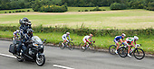 Media motorcycle filming the cyclists close up.  Olympics 2012.  Women's cycle road race passes along the Shere bypass, the A25, on it's way to Box Hill and then back to the finish in London.