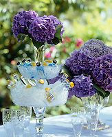 A novel way to serve drinks, this tiered glass stand has been filled with ice, mini gin and tonic bottles and decorated with Hydrangeas