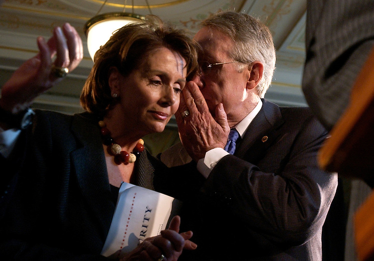 Senate Majority Leader Harry Reid, D-Nev., has a word with House Minority Leader Nancy Pelosi, D-Calif., at an event at Union Station, that unveiled the comprehensive Democratic plan to protect America called Real Security.  Democratic members of the House and Senate attended the event.