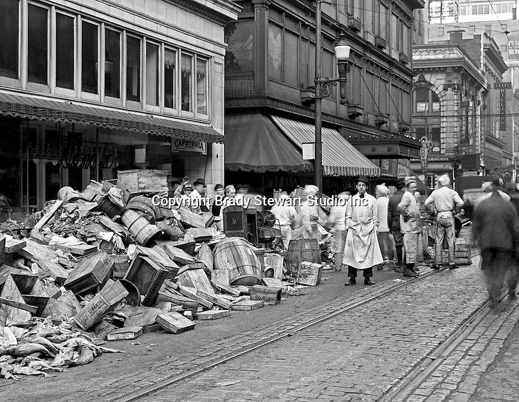 Pittsburgh PA:  View of the flood damage at Diamond and Wood Streets after the flood - 1936.    About 100,000 buildings were destroyed and the damage was estimated at about $250 million. Sixty five percent of the downtown business district had been under water from the Point all the way up to Grant Street.
