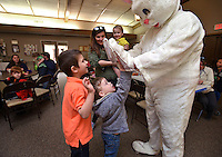 NWA Democrat-Gazette/BEN GOFF -- 03/21/15 Isaac Meister (left), 6, and Mason Carr, 4, high five the Easter bunny during the pancake breakfast and Easter egg hunt at First United Methodist Church of Bella Vista on Saturday, Mar. 21, 2015.
