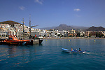 Couple in boat entering harbour showing beach and town of los Cristianos, Los Cristianos,Tenerife, Canary Islands, Spain.
