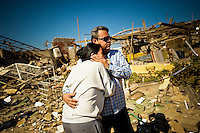 A couple embraces after seeing their destroyed home for the first time. Their home, which once stood two blocks from the Amuay refinery in Punto Fijo, Venezuela, was converted to rubble when the plant's huge storage fuel tanks exploded early Saturday morning, killing at least 39 people.