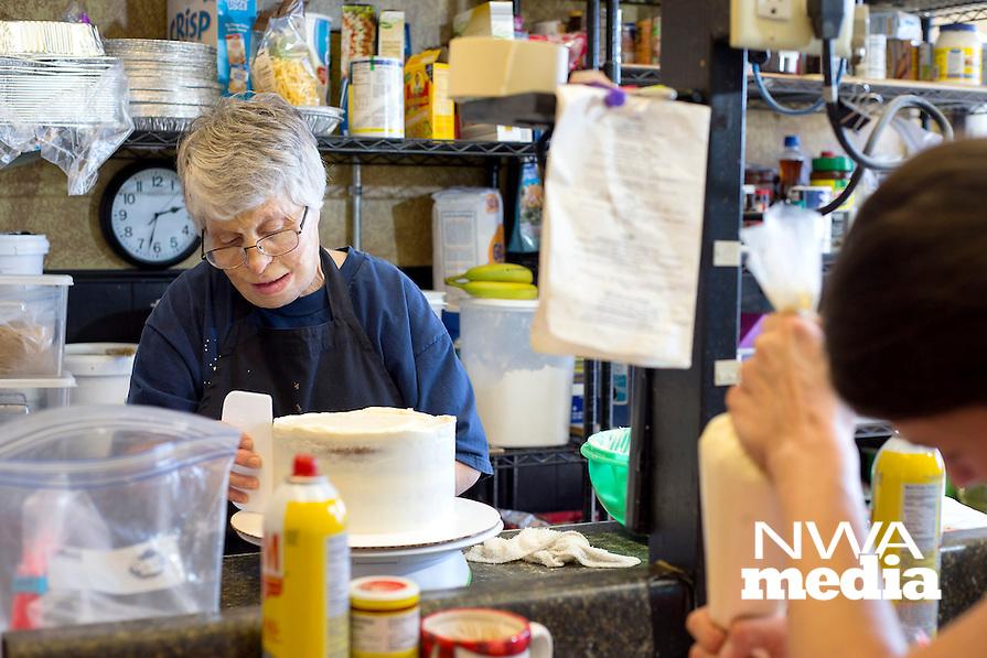 NWA Democrat-Gazette/JASON IVESTER<br /> Pat Bullard, owner of Pat's Bakery, spreads frosting on a cake on Wednesday, Jan. 25, 2017, at the Bentonville business.