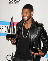 LOS ANGELES - NOV 21:  Usher in the Press Room of the 2010 American Music Awards at Nokia Theater on November 21, 2010 in Los Angeles, CA