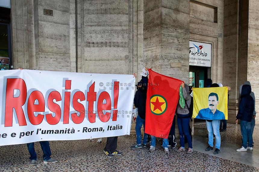 Roma 16 Ottobre 2014<br /> Attivisti della Coalizione Popolare per Kobane  e per l'umanit&agrave; sanziona  l'ufficio della Cultura e Turismo dell'Ambasciata della Turchia in Piazza della Repubblica con lancio di vernice rossa,frattaglie di animali,scritte sulla vetrine e fumogeni in solidariet&agrave; con la resistenza kurda di Kobane, la citt&agrave; a nord della Siria al confine con la Turchia che resiste all'Isis.<br /> Rome October 16, 2014 <br /> Activists of the Popular Coalition to Kobane and humanity sanctions  the Office of Culture and Tourism of the Embassy of Turkey in Piazza della Repubblica with the launch of red paint, animal offal, written on the windows and smoke bombs in solidarity with the Kurdish resistance of Kobane, the city in northern Syria on the border with Turkey that resists the  ISIS.