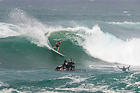 Sunset Beach, Oahu, HAWAII: (Wednesday, December 2, 2015): Joel Parkinson (AUS)  with Brian Surat (HAW).  Wave built during the day at the Vans World Cup of Surfing with wave heights reaching 10 - 12ft later in the day. Round 3 was completed with some big scores handsome big names being knocked out.   Photo: joliphotos.com