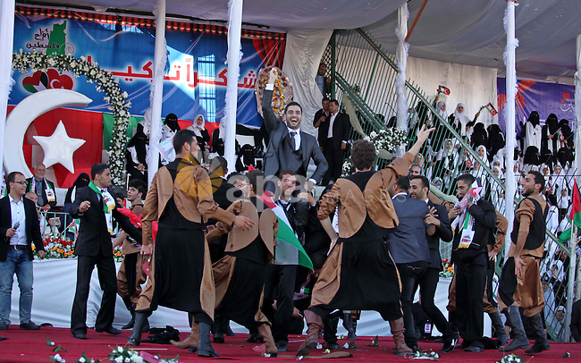Palestinian grooms celebrate during a mass wedding ceremony in Gaza City, on May 31, 2015. Nearly 2000 Palestinian couples were married in a ceremony funded by the Turkish government and supported by the Hamas movement. Photo by Ashraf Amra