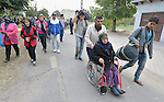 Refugees and migrants, including some living with disabilities, walk through the Hungarian town of Hegyeshalom on their way to the border where they will cross into Austria. Hundreds of thousands of refugees and migrants flowed through Hungary in 2015, on their way from Syria, Iraq and other countries to western Europe.