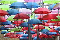 Multi-coloured umbrellas hanging, London Bridge, UK. Picture by Manuel Cohen