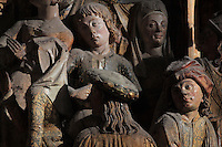 People in the crowd waiting to be baptised by St Firmin, Gothic style polychrome high-relief sculpture from the South side of the choir screen, 1490-1530, commissioned by canon Adrien de Henencourt, depicting the life of St Firmin, at the Basilique Cathedrale Notre-Dame d'Amiens or Cathedral Basilica of Our Lady of Amiens, built 1220-70 in Gothic style, Amiens, Picardy, France. St Firmin, 272-303 AD, was the first bishop of Amiens. Amiens Cathedral was listed as a UNESCO World Heritage Site in 1981. Picture by Manuel Cohen