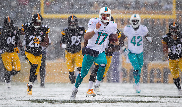 Ryan Tannehill runs for a first down in the first quarter as the Pittsburgh Steelers host the Miami Dolphins at Heinz Field on Sunday, December 8, 2013.
