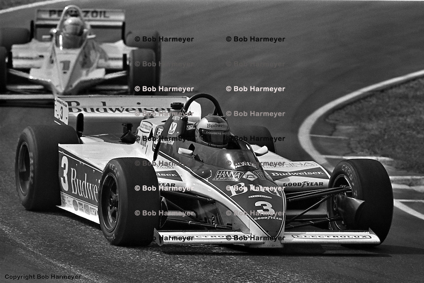 LEXINGTON, OH - SEPTEMBER 11: Mario Andretti drives his Lola T700/Cosworth ahead of Rick Mears during the Escort Radar Warning 200 on September 11, 1983, at the Mid-Ohio Sports Car Course near Lexington, Ohio.