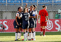USA's Alex Morgan celebrates her goal against Germany with teammates during their Algarve Women's Cup soccer match at Algarve stadium in Faro, March 13, 2013.  .