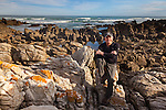 Photographer Art Wolfe at the southern most edge of the African continent, Cape Agulhas, South Africa