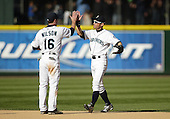 04 October 2009: Seattle Mariners #16 Josh Wilson and #51 Ichiro Suzuki high five after the game against the Texas Rangers. Seattle won 4-3 over the Texas Rangers at Safeco Field in Seattle, Washington.