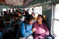 Passengers share a laugh en route to Huancavelica.