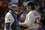 New York Mets Pitcher R.A. Dickey ( R) speaks with catcher Josh Thole during their game against Miami Marlins at Citi Field Stadium in New York. Photo by Eduardo Munoz Alvarez / VIEW.