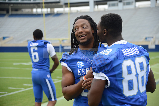 Kory Brown a sophomore linebacker talks with freshman teammate J.D. Harmon at UK Football Media Day on Friday, August 3, 2012. Photo by Mike Weaver| Staff
