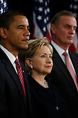 Chicago, IL - December 1, 2008 -- United States President-elect Barack Obama gives a press conference to introduce nominees United States Senator Hillary Rodham Clinton, for Secretary of State, middle, and retired Marine General James L. Jones, right, as national security adviser.  Obama also introduced Washington Lawyer Eric Holder, for Attorney General, Arizona Governor Janet Napolitano, for homeland security secretary, and Susan Rice as U.N. ambassador Monday morning, December 1, 2008 at the Chicago Hilton & Towers in Chicago, Illinois. Obama said he would keep defense secretary Robert Gates in his current post.  .Credit: Anne Ryan - Pool via CNP