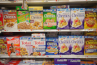 Boxes of General Mills breakfast cereals mixed in with house brand similars on supermarket shelves on Wednesday, August 22, 2012. (© Richard B. Levine)