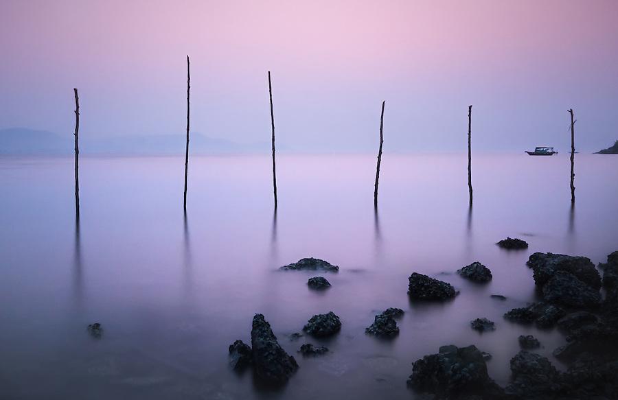 HA LONG BAY, VIETNAM - CIRCA SEPTEMBER 2014:  Sunrise in Halong Bay, Vietnam