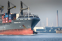 A close up view of the bow of the container cargo ship, Pomerenia Sky as she leaves the Port of Tilbury and steams downriver on the River Thames.