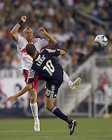 New York Red Bulls midfielder Joel Lindpere (20) and New England Revolution forward Rajko Lekic (10) battle for a high pass. In a Major League Soccer (MLS) match, the New England Revolution tied New York Red Bulls, 2-2, at Gillette Stadium on August 20, 2011.