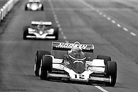 HAMPTON, GA - APRIL 22: Bobby Unser drives his Penske/Cosworth TC ahead of teammate Rick Mears and others during the Gould Twin Dixie 125 event on April 22, 1979, at Atlanta International Raceway near Hampton, Georgia.