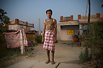 R&R - Rabi Chhachhan (32) next to his house in the new resettlement colony at Jharsuguda. He is enrolled in a training programme to increase his employment opportunities according to the R&R policy.
