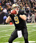 New Orleans Saints QB Drew Brees looks down field to make a pass during the game against the Tampa Bay Buccaneers Sunday Jan. 2,2011. The Bucs went on to win 23-13. The New Orleans Saints play the Tampa Bay Buccaneers in the last Sunday game of the regular  season before the playoffs in New Orleans at the Super Dome in Louisiana Sunday Jan 2, 2011.Photo©SuziAltman