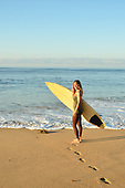 Woman getting ready to spend a morning surfing