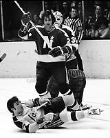 Seals vs Minnesota North Stars, Seals Hilliard Graves on ice, with Danny Grant standing <br />