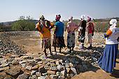 Zimbabwean women look at a dried out fish farm in their village in Masvingo Province, Zimbabwe. <br /> <br /> Drought in southern Africa is devastating communities in Zimbabwe, leaving 4 million people urgently in need of food aid. The government declared a state of emergency,. <br /> <br /> Here in Masvingo Province, the country's hardest hit province, vegetation has wilted, livestock is dying, and people are at serious risk of famine. <br /> <br /> Pictures shot by Justin Jin