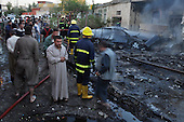 KIRKUK, IRAQ: A man stands in shock a the scene of a triple car bomb...At 6 am, three car bombs detonated in the peaceful Kurdish neighborhood of Imam Kasimin Kirkuk.  There were 17 casualties.  Kirkuk is Iraq's most ethnically mixed city and is one month away from a volatile census that will determine the future of the city...Photo by Ari Mohammad/Metrography.