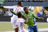 November, 2013: CenturyLink Field, Seattle, Washington: Seattle Sounders FC forward Eddie Johnson (7) gets up close with the ball  as the Portland Timbers take on the Seattle Sounders FC in the Major League Soccer Playoffs semifinals Round. Portland won the first match 2-1.
