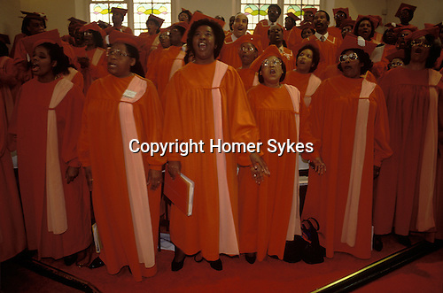 The red robbed choir of the Calvary Church of  God in Christ. South London. from A STORM IS PASSING OVER a Look at Black Churches in Britain. Calvary Church of  God in Christ is part of the generic term for these groups of churches who we call the  Church of God of Prophecy. Published by Thames and Hudson isbn 0 500 27826 1