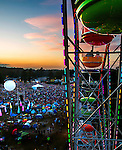 Personal Work<br /> <br /> Taking the giant ferris wheel ride as Gov't Mule plays during the Wanee Festival at the Spirit of the Swanee campground in Live Oak, Florida  April 12, 2014.