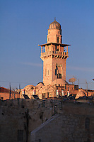 The minaret of a mosque adjacent to the Dome of the Rock is visible from the area of the Western Wall in Jerusalem.