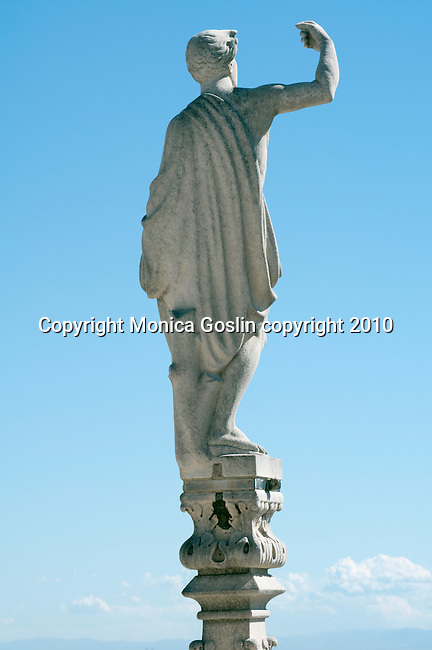 A statue that looks over the city, on the roof of the Duomo (Cathedral) in Milan, Italy.