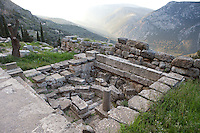 DELPHI, GREECE - APRIL 12 : A general view of the Sicyonian Treasury overlooking the slopes of the Mount Parnassus on April 12th, 2007, in the Sanctuary of Apollo, Delphi, Greece. The Treasury of Sicyon was built in the 6th century BC, circa 525 BC in the Ionic order. It is notable for remains of older Doric structures re-used in its foundations. (Photo by Manuel Cohen)