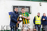 Lispole captain Declan O'Sullivan receives the Munster Junior B Club Football Cup from John Cregan, Chairman Limerick Football Board following his sides victory over Ballyhooly in Knockaderry